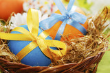 Fototapety Colorful easter eggs in the basket