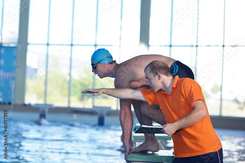 swimmer practice jump with trainer