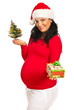 Pregnant woman giving Xmas gift