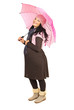 Happy pregnant woman with umbrella