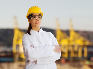 female worker against  shipyard background