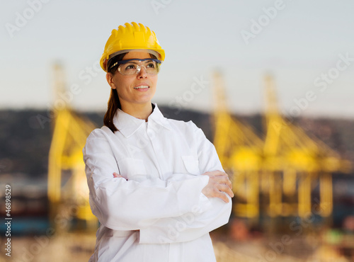 female worker against  shipyard background