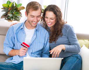 Online Shopping. Couple Using Credit Card to Internet Shop