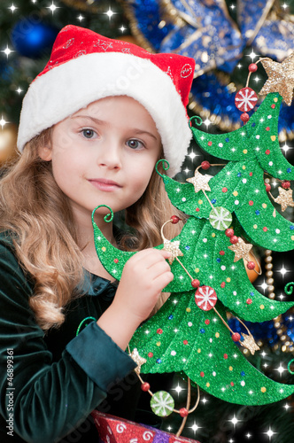 Christmas - lovely girl in Santa hat with Christmas tree