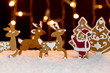 Christmas setting - gingerbread deers and santa