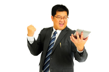 Big businessman excited with tablet