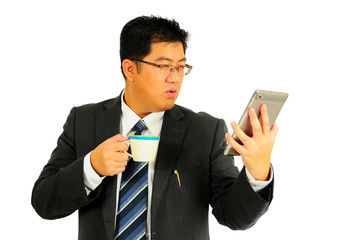 Big businessman excited with tablet and coffee