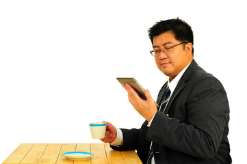 Big businessman working on table with tablet and coffee
