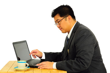 Big businessman working on table with laptop and coffee