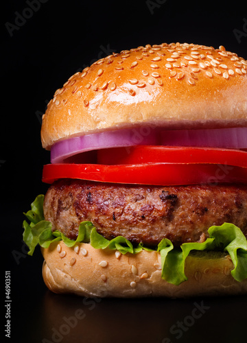 Burger on black background