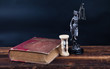 old book and temida statue