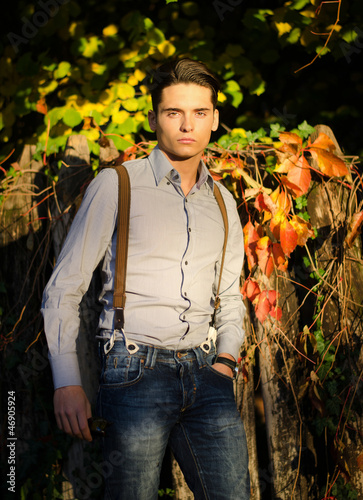 Attractive young male model in fall (autumn) outdoors in nature