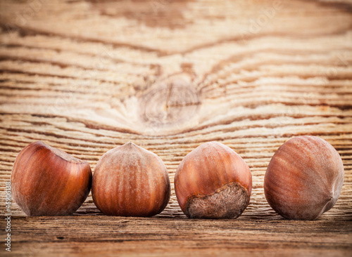 Hazelnuts (filbert) on old wooden table. Close-up