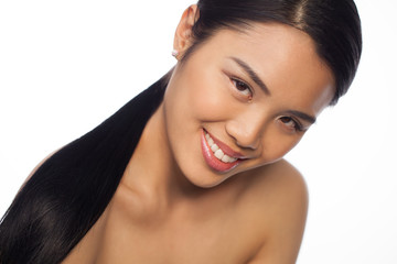 Smiling beautiful young Asian woman