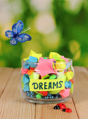 Glass vase with paper stars with dreams