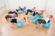 Class of diverse people doing pilates
