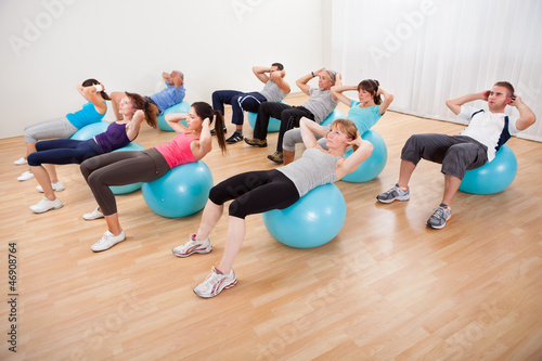 Poster Fitness Class of diverse people doing pilates