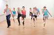 Group of people doing aerobics exercises - 46908930