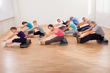 People doing stretching exercises