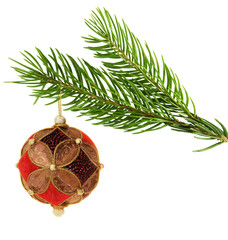 ornate christmas ball hanging on a pine branch,isolated