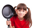 Little girl holding a frying pan