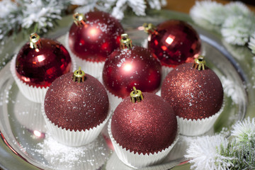 Christmas baubles in cup cupcakes food concept