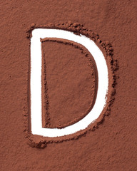 Letter D made of cocoa powder