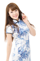 Beautiful asian woman in traditional Chinese Cheongsam