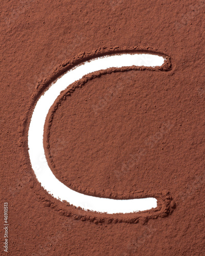 Letter C made of cocoa powder