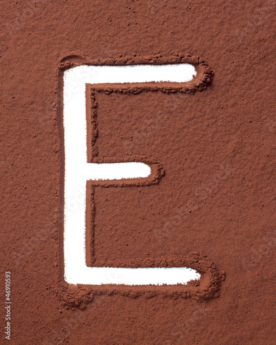 Letter E made of cocoa powder