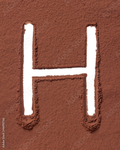 Letter H made of cocoa powder