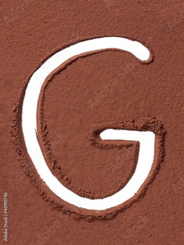 Letter G made of cocoa powder