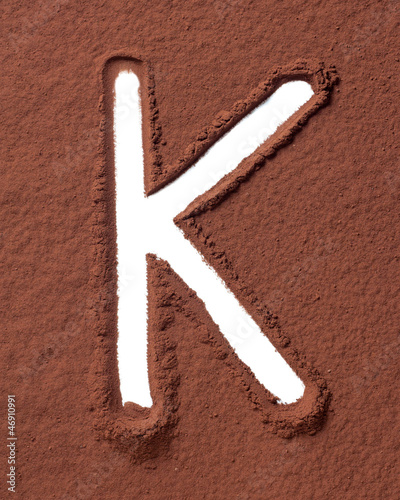 Letter K made of cocoa powder