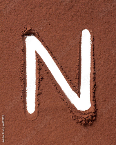 Letter N made of cocoa powder