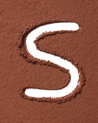 Letter S made of cocoa powder