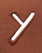 Letter Y made of cocoa powder