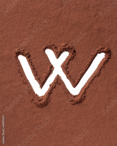 Letter W made of cocoa powder