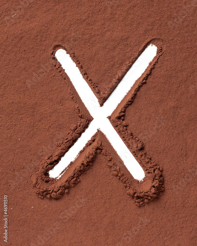 Letter X made of cocoa powder