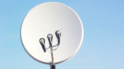 Satellite dish in blue sky - Time-lapse
