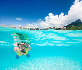 Woman snorkeling in a tropical lagoon