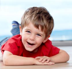 three years old boy having fun
