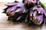 artichokes close on rustic wood background
