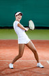 Tennis training. Female player at the clay tennis court