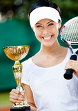 Female tennis player won the cup at the sport competition. Prize