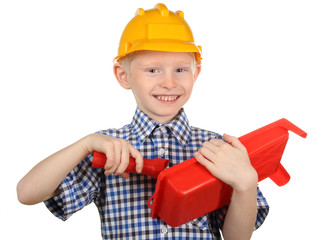 Boy in the construction helmet and a paint roller
