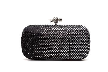 Black handbag on white
