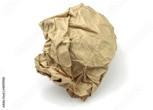 Crumpled brown paper on white background.