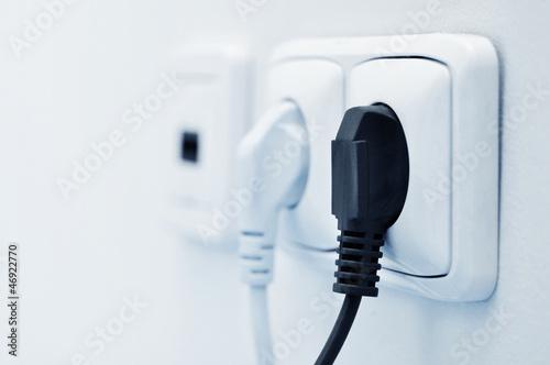 Leinwandbild Motiv electric plug in a socket