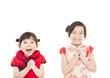 happy chinese new year. two asian girls with Congratulation gest