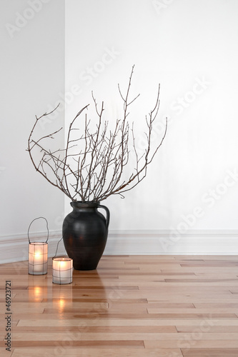 Lanterns and tree branches decorating a room